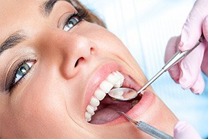 Closeup of patient receiving dental treatment