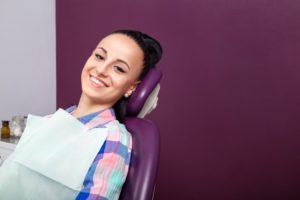 Woman smiling in dental chair during routine dental visit