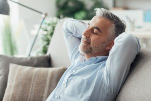 man relaxing after dental implant surgery in East Longmeadow and Northampton